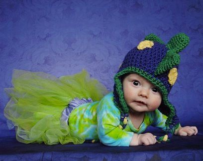 RAWR! This hat is made from soft and warm yarn, and will turn any little one into a dinosaur! With standing spikes and round spots, this hat tops
