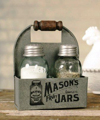 """Mason's Jars Box Salt And Pepper Caddy with Wood Handle - Box of 2 This charming Mason jar caddy measures 4"""" wide, 2"""" deep, and 5½"""" tall to top of handle. This caddy holds one salt and pepper shaker set with the classic Mason jar logo printed on the front."""
