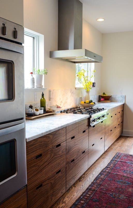 When we renovated our kitchen a little over a year ago, we chose to put in honed marble countertops