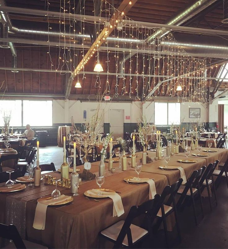 Repair Garage building at the Packard Proving Grounds Historic Site in Shelby Twp, MI. Wedding Reception. Head table. twinkle lights. wine bottle centerpieces.