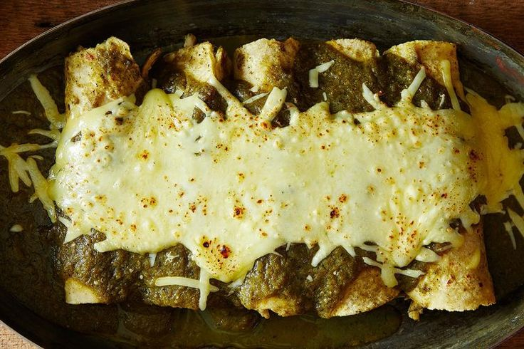 """Enchiladas Suizas  Cooks Notes: These TASTED GOOD but the corn tortilla shell almost disintegrated! It was very hard to get it out in a whole piece. The next time I make this I will make it """"casserole style"""" by laying the tortilla shells in either layers similar to Lasagna or with 1 on the bottom & 1 on the top."""