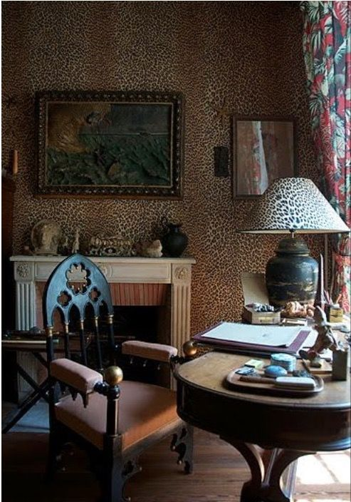 Parisian decorator, Madeleine Castaing, employed leopard wallpaper on walls and ceiling as well as lampshades and carpeting in Jean Cocteau's study in Paris.