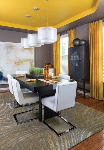Bright Solid Yellow Drapes Shine Onto This Modern Dining Room