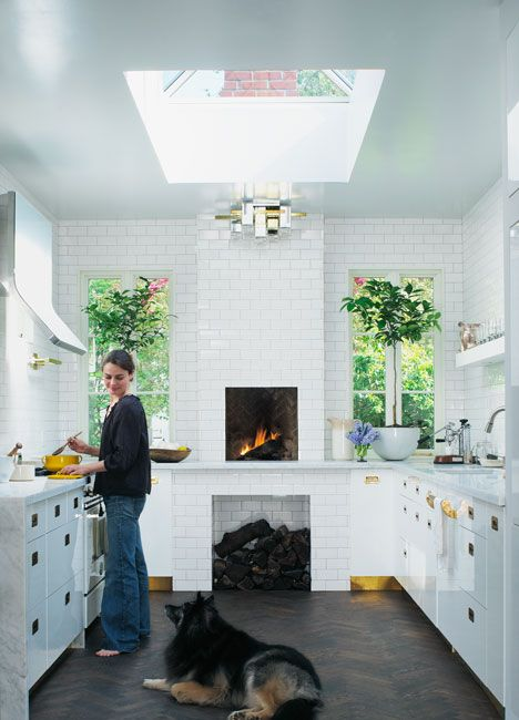 Wood fireplace & giant skylight...that's a great kitchen: Dreams Kitchens, Kitchens Design, Subway Tile, Brass Hardware, Interiors Design, Sky Lights, Modern Kitchens, Kitchens Fireplaces, White Kitchens