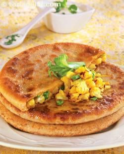 Gobi Paratha, cauliflower with onions and masala stuffed in whole wheat dough, rolled and cooked on a tava.