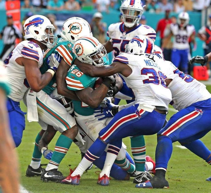 Bills vs. Dolphins:    October 23, 2016  -  28-25, Dolphins  -      Miami Dolphins Damien Williams drags the Buffalo Bills defense into the end zone to score a fourth quarter touchdown at Hard Rock Stadium in Miami Gardens, Florida, October 23, 2016. CHARLES TRAINOR JR ctrainor@miamiherald.com