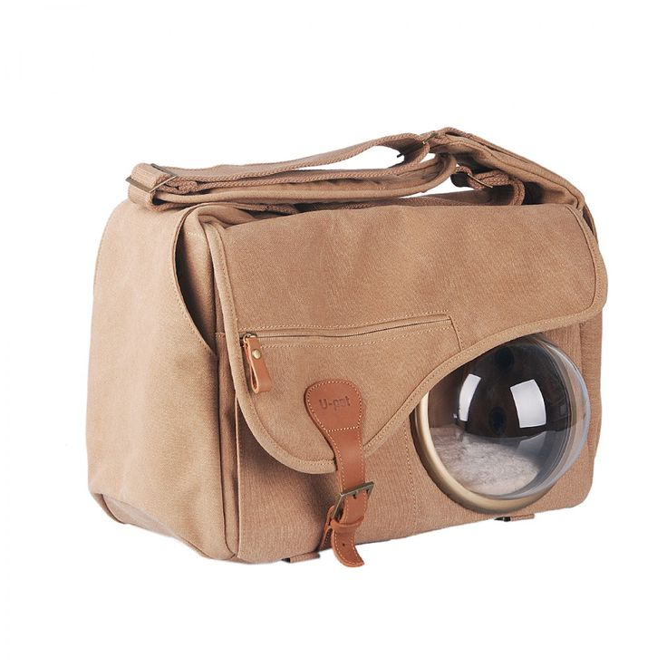 Pet carrier with a window to the world!...I don't see the holes to breathe but it must have some...