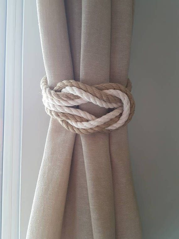 These lovely curtain tiebacks are made from soft beige hemp rope.  Hemp rope - 3 Strand construction. Soft to touch, will not shrink or swell when wet.  Knot size: 6 x 3.5  The tiebacks are sold in pairs and singles. For custom sizes, please get in touch.  Care Instructions : Wipe using a damp cloth and allow to air dry. Do not wash. Wall fittings are not included. Curtains used in this listing are of standard width thin and not lined. I recommend using longer ties for full, lined curtains.