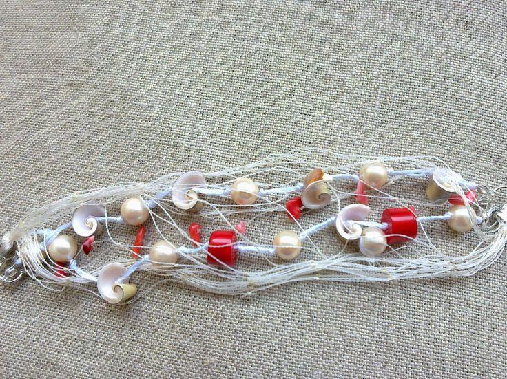 Bracciale con coralli rossi perle con con rete da pesca.  Ritiro gratuito su Catania e Provincia    Le  Peonie Gioie - Accessori peonie.accessori@gmail.com      tel . 339/8778952