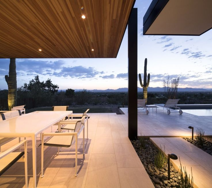 Kendle Design Collaborative have designed a rammed earth house in Paradise Valley, Arizona.  same floors used inside and out