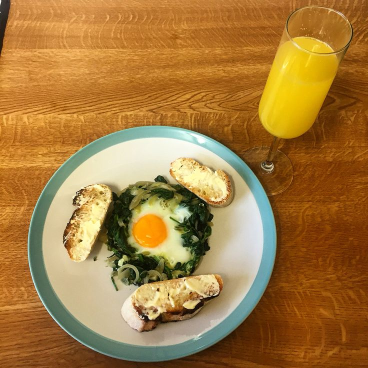 New Year's Day brunch - baked spinach and eggs with sour dough toast and Buck's Fizz