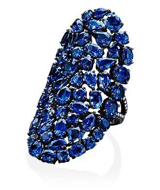 Cellini Jewelers flexible sapphire ring. 13.79 carats of sapphires and .19 carats of diamonds make up this magnificent statement ring. The concave shape and articulated setting makes for an exceptionally comfortable ring. Set in 18 karat blackened gold.