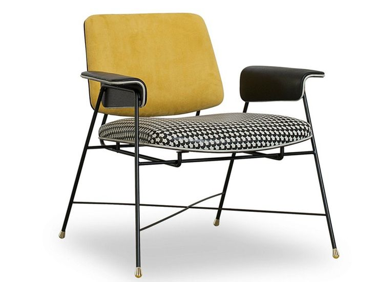 Easy chair inspired by the 50s by designers Draga & Aurel. The 'Bauhaus Baxter' has a sputnik-like steel frame, hound's tooth-print leather seat and saffron leather back.