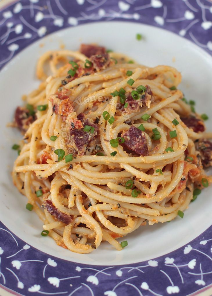 Mimicking the Filipino egg-sausage-tomato meal, this spaghetti dish has a rich sauce made with pureed salted duck egg, sun-dried tomatoes and basil.