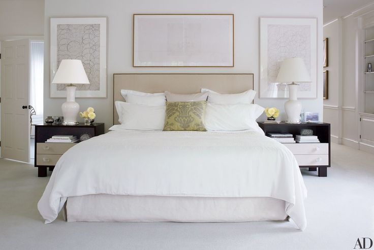 In the master bedroom of designer Victoria Hagan's Connecticut home, the bedside tables are by Victoria Hagan Home Collection, the headboard was custom made, the lamps are by Antony Todd, the bed linens are by Frette, and the white silk coverlet is by Calvin Klein Home.
