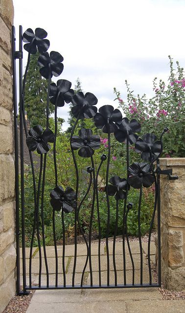 The back view of the Poppy Gate. The lower flower heads were turned around to add interest.  Hand forged by Nottinghamshire based Artist Blacksmith Adrian Stapleton of Trinity Forge.: Modern Gardens, Flowers Gardens, Fence, Flowers Gates, Wrought Irons Gates, Gardens Design Ideas, Interiors Design, Gardens Gates, Interiors Gardens