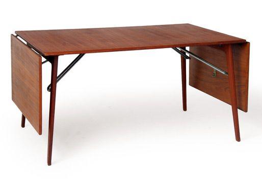 Mesa de teca extensible.