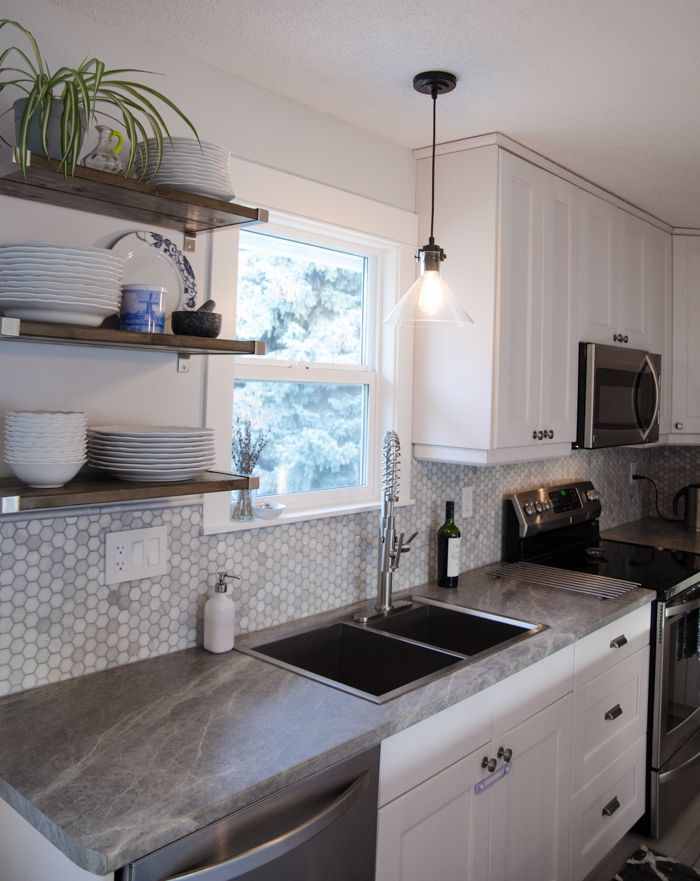 Before and After - DIY Kitchen Renovation White cabinets w/ gray countertops & gray backsplash!