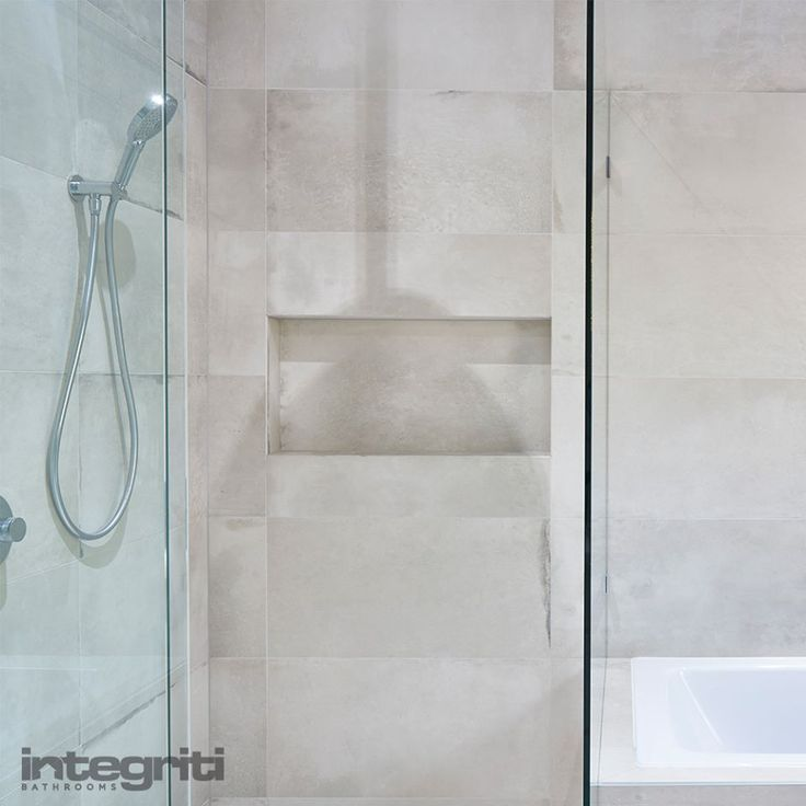 Get rid of all those racks and holders in your shower, taking away from the look and feel of your bathroom. Opt for a custom recessed shelf or shower nook in your next bathroom renovation and have it designed to suit your needs and the overall aesthetic of the room. #integritibathrooms #custommade #sydneybathroom #interiordesign #bathroom #bathroomremodel #bathroomrenovation #sydneybathrooms #sydneyrenovations #modernbathroom #showershelf #showernook #recessedshelf #luxury #modern #design