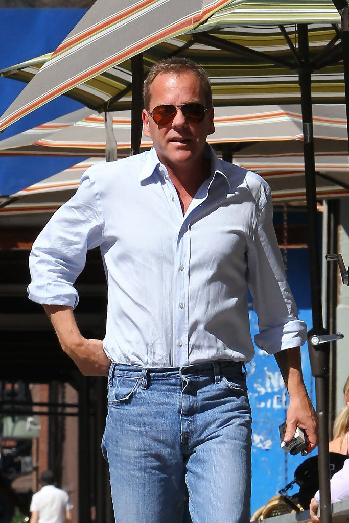 """Kiefer Sutherland Photos Photos - Kiefer Sutherland spotted having an outdoor meal with his girlfriend Siobhan Bonnouvrier and a friend at a restaurant in the West Village. The clean shaven """"24"""" star is seen leaving the restaurant separately. - Kiefer Sutherland Gets Lunch in the West Village"""