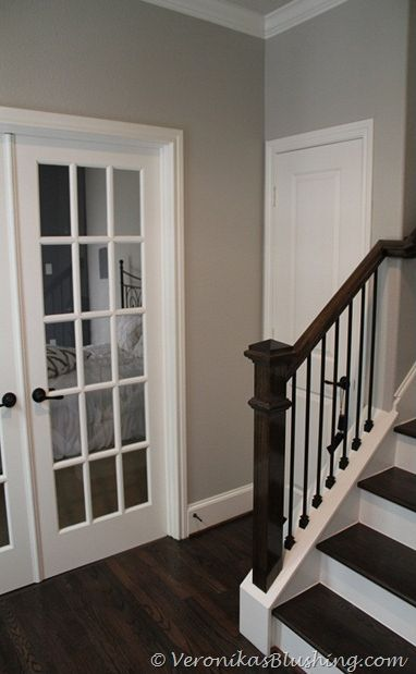 Wall Paint color - Revere Pewter Benjamin Moore - like it with the white and dark staircase - switch out spindles to wrought iron eventually??