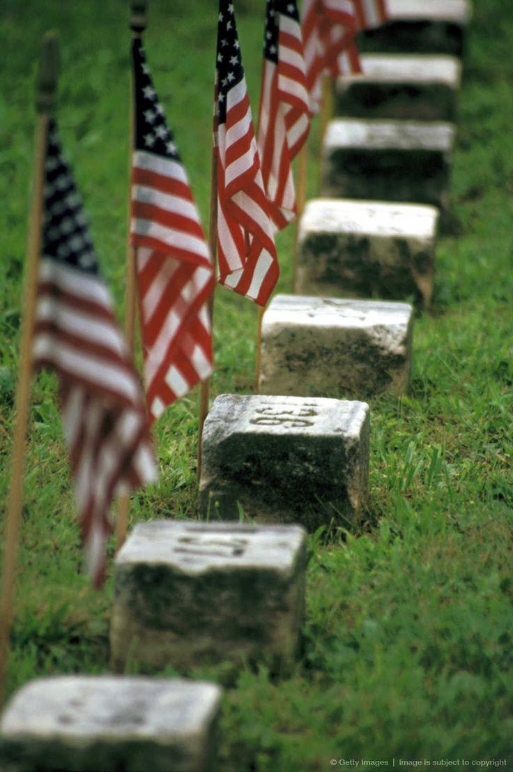 American flags by graves at Civil war cemetery, Gettysburg, Pennsylvania, USA