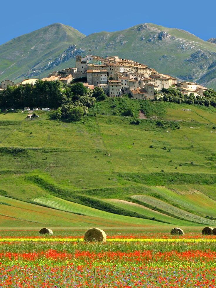 Castelluccio di Norcia in the Apennine Mountains of Central Italy. It is a lovely, scenic drive up the mountain from Norcia, but what a surprise when you finally reach the 'top' and have the enormous panorama open up before you - it takes your breath away.