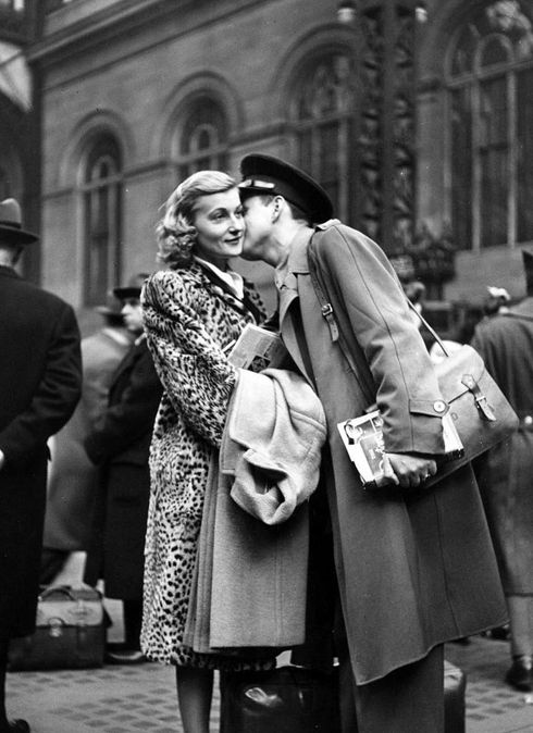 """""""A Soldier's Farewell"""", by Alfred Eisenstaedt. At Pennsylvania station in 1943. 40s print magazine ad layout girl in leopard coat 40s"""