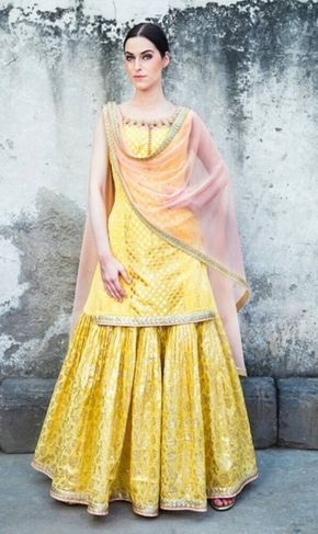 Sangeet Outfit - Yellow Kurta with a Yellow Skirt and Pink Net Dupatta | WedMeGood Outfit by: Liz Paul #wedmegood #indianbride #indianwedding #sangeetlehenga #lehenga #yellow #lizpaul #kurtalehenga