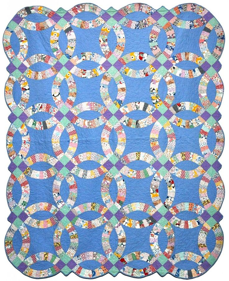 Double Wedding Ring quilt – c. 1930, very rare – most were made on white background. Collection of Bill Volckening. Posted at Why Quilts Matter