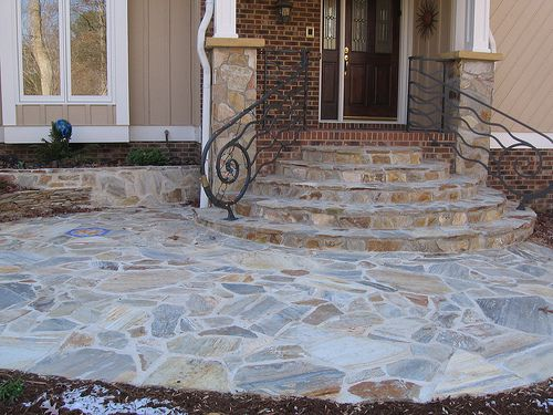 Stone Columns With Flagstone Steps And Walkway On The