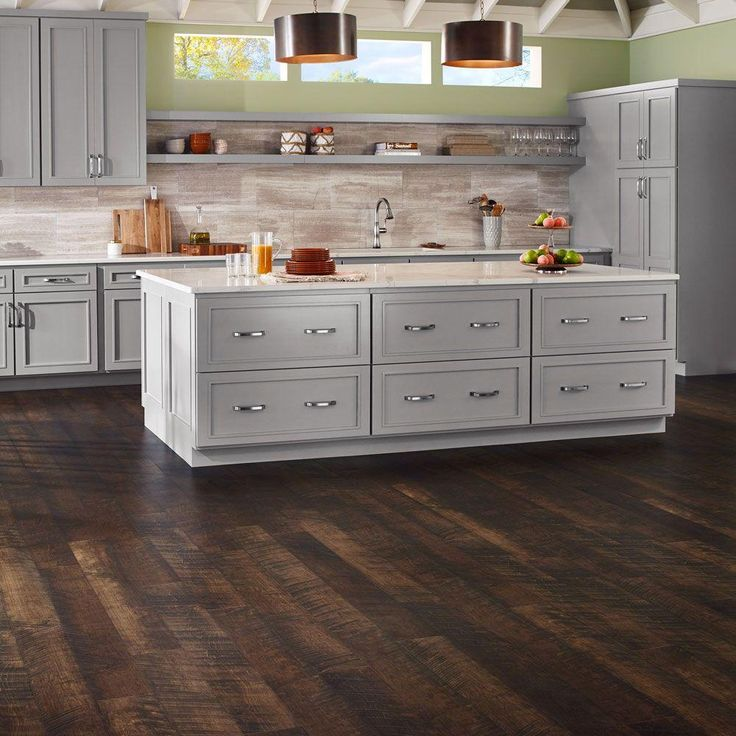 This laminate flooring has all the luxury you need with its rustic, worn finish and natural wood look. Water resistant for up to 24 hours, you can feel good knowing that your floor can handle almost anything you throw at it. This flooring is one of The Home Depot's most pinned products.