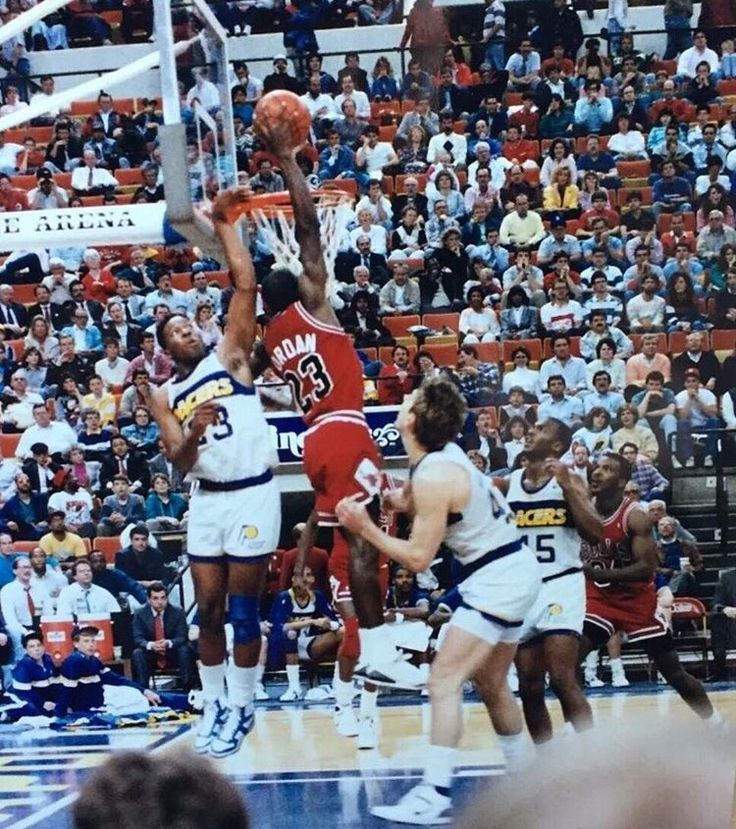 Rare Air. The GOAT skies for a dunk over the Pacers Detlef Schrempf and the late Wayman Tisdale in Indianapolis.