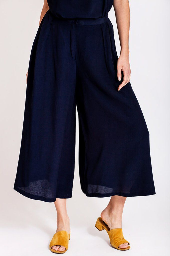 Wide Pants by Dott. A walk on the beach, the wind in your hair, the sun on your skin and the sand caressing your feet. Maybe you are lucky and are right now enjoying your holidays. But hold on a minute, don't you need a pair of flowy pants for the occasion? There is nothing worse than feeling the tight pants on your warm skin when you go for a walk on the beach. These wide pants by Dott. will do the trick and you would even look amazing in them.   €120.00 REPIN TO YOUR OWN INSPIRATION BOARD