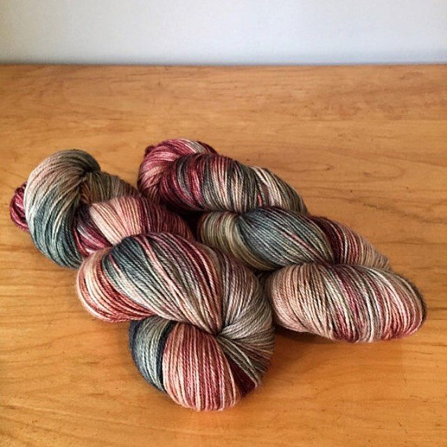 """For my first dye day after a little break I filled the dyepots with """"Garland"""" one of my holiday colourways. They are up on the drying rack now but this is what they look like all dry and ready to knit  #juliannasfibre"""