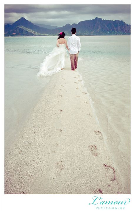 Bride and Groom walking on the sand during a Hawaii Wedding on Oahu