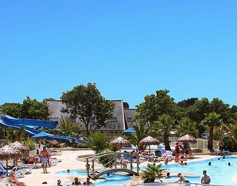 Camping Le Cabellou Plage : beach over the road, pool slides,  bike hire. + walking. Bike to beaches. Entertainment + beach can be noisy. good size pitches good reviews