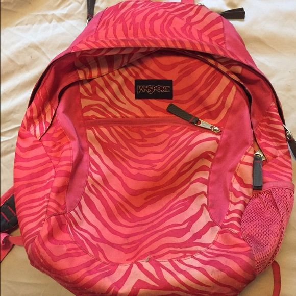 flash sale Pink Jansport backpack Wide and excellent condition. All zippers work and straps in good order, zebra pink design. EUC. Jansport Bags Backpacks