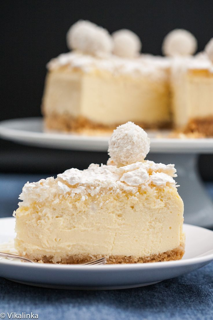 Coconut cheesecake sits on top of an almond and coconut wafer crust and topped with crunchy coconut meringue.