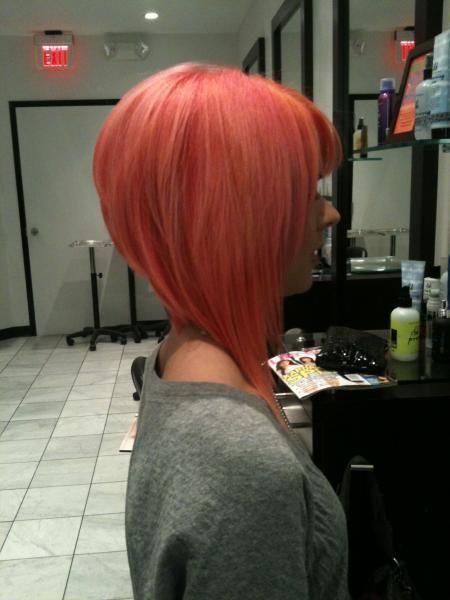 A line bob. Pink hair.