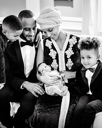 Gorgeous! Alicia Keys revealed the first photo of her new baby Genesis in a stunning family portrait posted to Instagram on Friday, Feb. 27.