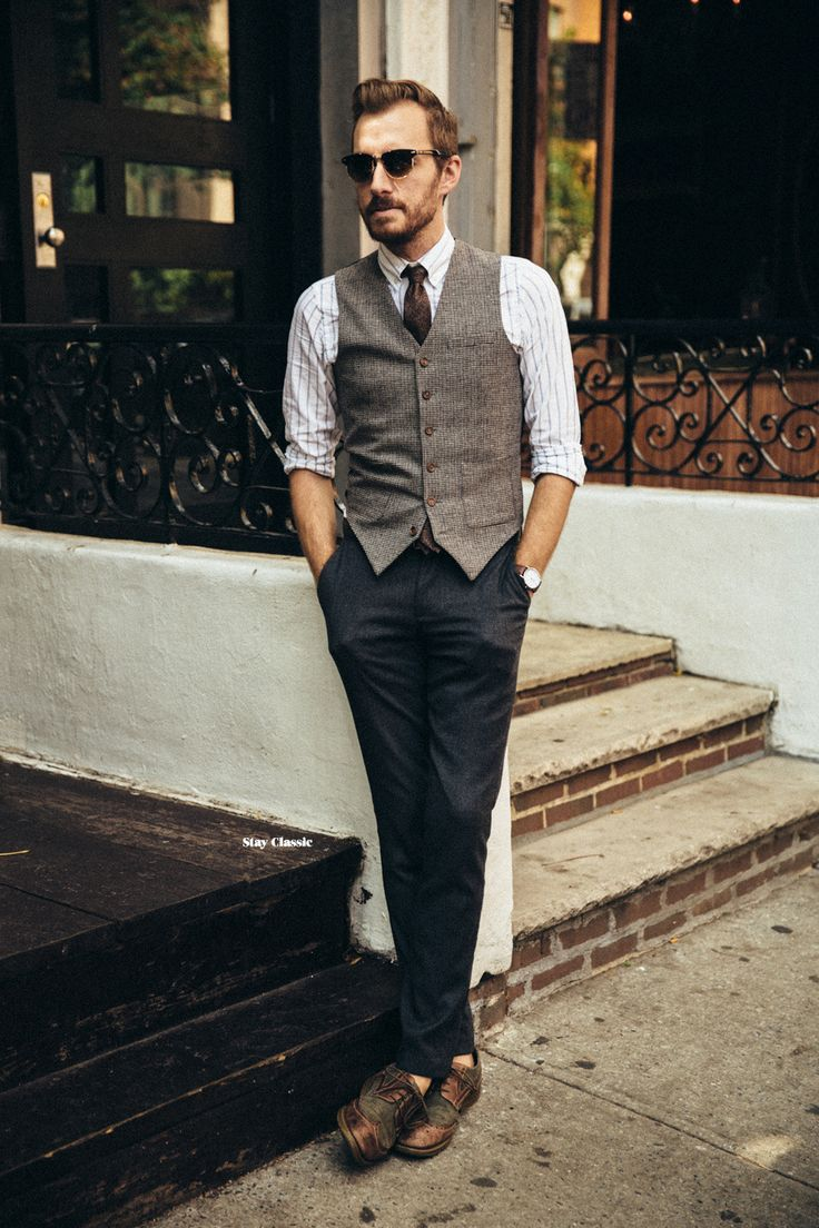 Something as simple as opting for a brown wool waistcoat and navy suit pants can potentially set you apart from the crowd. For a more relaxed take, grab a pair of dark brown leather brogues.   Shop this look on Lookastic: https://lookastic.com/men/looks/waistcoat-long-sleeve-shirt-dress-pants/14535   — Dark Brown Sunglasses  — White Vertical Striped Long Sleeve Shirt  — Dark Brown Tie  — Brown Wool Waistcoat  — Navy Dress Pants  — Dark Brown Leather Brogues