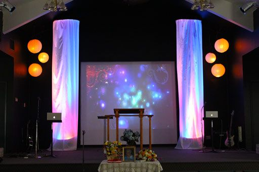 church stage idea hula hoops  and sheer fabric. Same ceiling type.