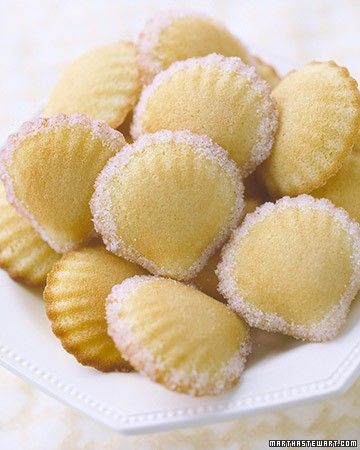 These miniature shell-shaped French sponge cakes are enhanced with rose water and sprinkled with pale-pink sugar.