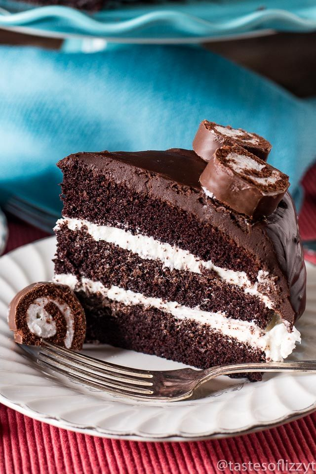 6 layers of homemade chocolate cake, fluffy white frosting and thick chocolate ganache make up this grown up ho ho cake. It's a grown-up version of your favorite lunch-room snack.
