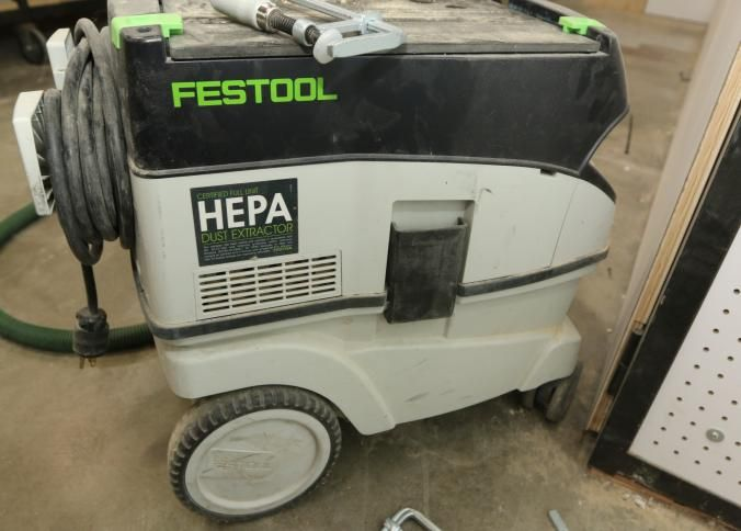 Festool vacuum model CT 26E with assorted attachments, and bags.