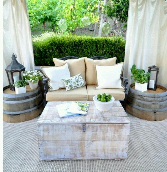 Rustic patio decor <3  Upside down barrel planters as side tables.  Love this!