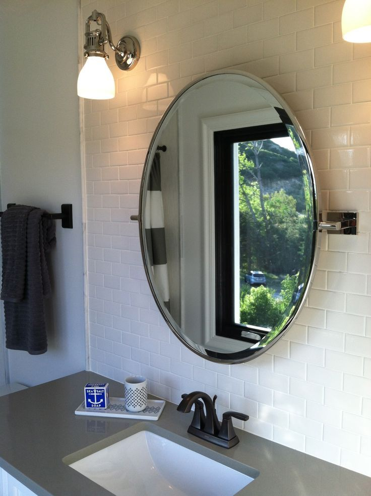 Bathroom Ideas Framed Oval Home Depot Mirrors Above Single Sink Vanity Under Wall Sconces In White Subway Tiles Take The
