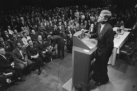 JFK.  Kennedy addresses the Houston Ministerial Association on the 'religious question' of his Catholicism. He received a standing ovation. Photograph: Stanley Tetrick/Corbis