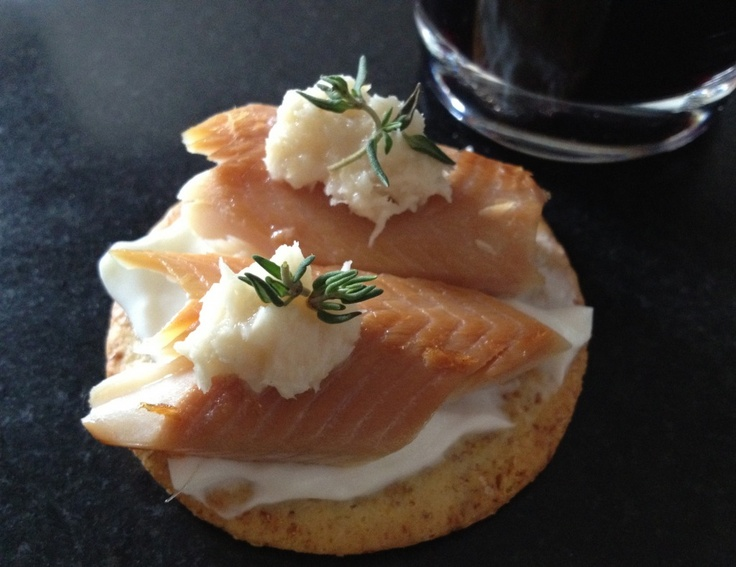 Smoked trout on a Breton cracker with a smear of plain Greek yogurt, a dab of horseradish and a bit of fresh thyme. | LOVE - The Secret Ingredient